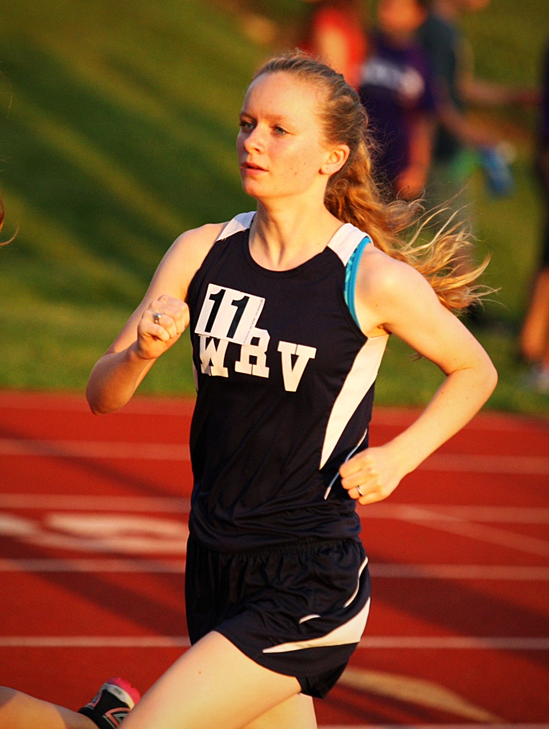 File Photo Christiane Davis of White River Valley rounds a curve during the 3200-meter run at the regional.