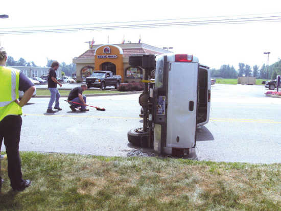 Local News: No one seriously injured when truck flips (8/2